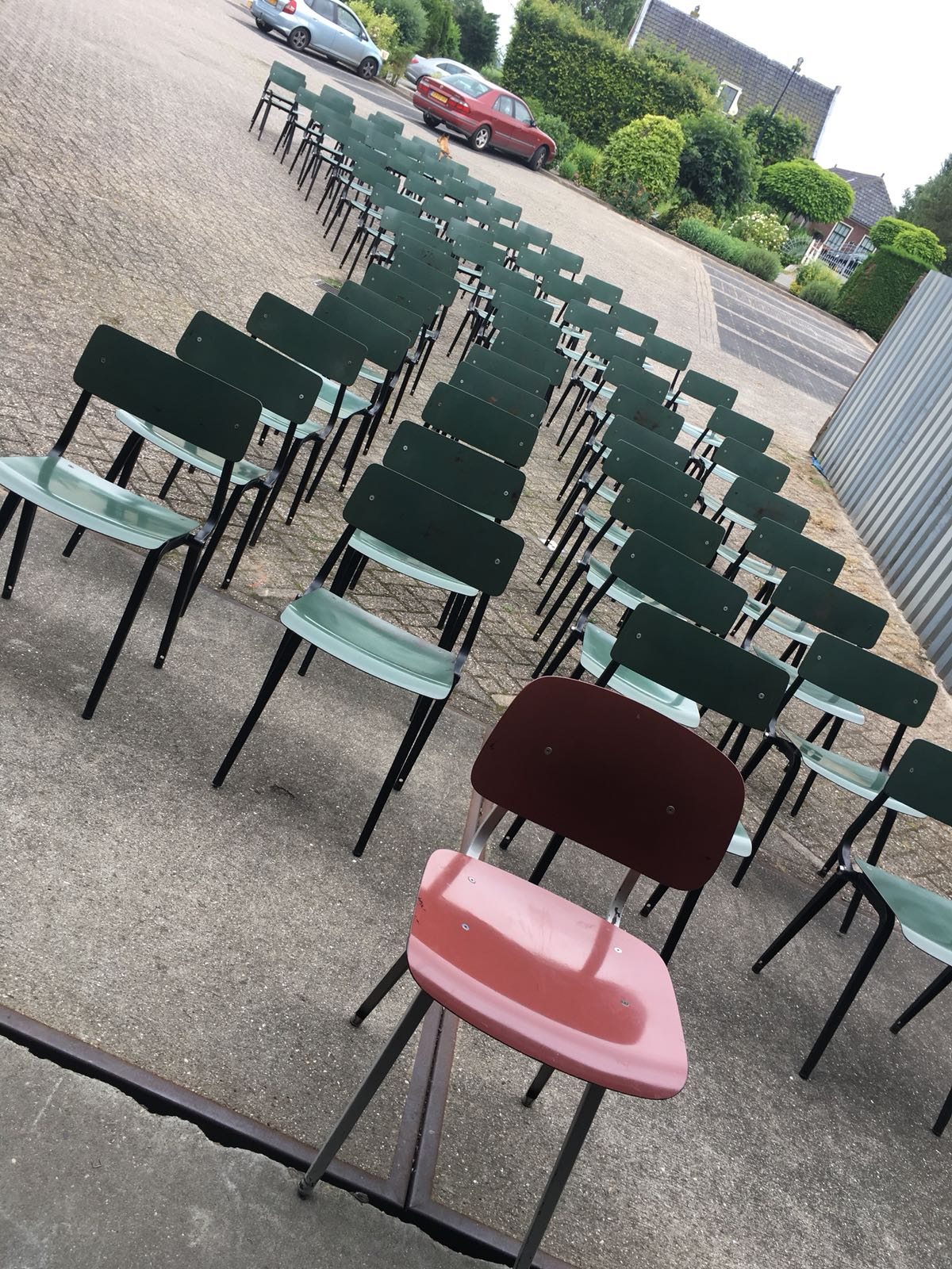 Midcentury Friso Kramer Theater chairs ready to steal the show at Galerie Gaudium, Amsterdam the Netherlands