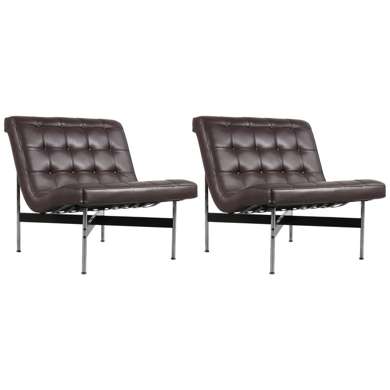 "A beautiful pair of lounge chairs designed circa 1960 by William Katavolos. This is a 1990s production by ICF in Milano, Italy, who got the official license to produce these pieces after Laverne International. The chairs have a high quality chrome plated frame with black lacquered metal supports. This creates a beautiful style that works really well with the brown leather upholstery, creating a nice modern style with a luxurious appearance. The original leather is in excellent condition, making this set a truly amazing find! We have a matching sofa available, making this an incredible find that would truly draw the attention in any decor. The set remains in excellent original condition! It has the manufacturer's label on the frame. William Katavolos's career as an avant-gardist spans 60 years, beginning in the late 1940s when, after giving up painting, he and fellow Pratt students Ross Littell and Douglas Kelley produced a furniture line including the ""T"" chair, which is now in the collection of MoMA and the Louvre. He went on in industrial design to conceive furniture collections for the legendary Laverne International, partition systems for Time-Life and Owens Corning, a suspension ring system for the Moscow Fair, and the Agricultural and Solar Pavilions for Salonika."